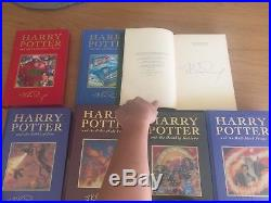 Complete set of First edition Harry Potter Books with the first 3 signed